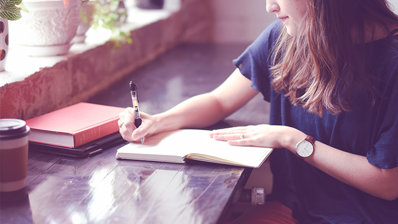 How to beat writer's block | woman writing in journal